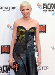 michelle williams stuns in sparkling snakeskin dress at manchester