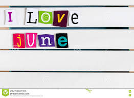 i love june written with color magazine letter clippings on wooden