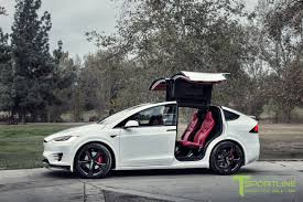 bentley black and red custom tesla model x with bentley red interior selling for 180k