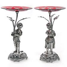 engraved dishes pair of figural boy and girl silver plated comports c 1890