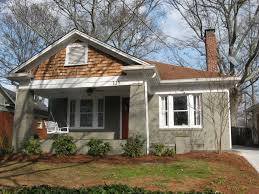 exterior front porch with window treatments and exterior paint