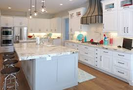 Range In Kitchen Island by Kitchen Awesome Alaska White Granite With White Wood Kitchen