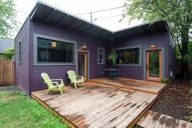 this purple backyard cottage might be tiny but it feels huge