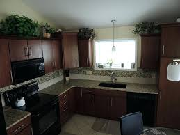 cabinets to go miramar miramar kitchen cabinets cherry paprika fusion granite morning mist