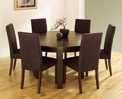 round walnut dining table lyon walnut round dining table amazon co uk kitchen home