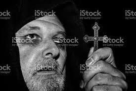 scarey scarred monk holding a cross stock photo more pictures of