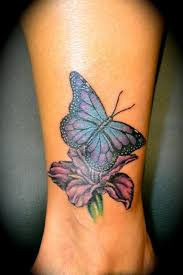 butterfly on flower on ankle butterfly tattoos