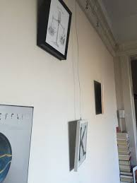 how to hang picture frames that have no hooks how to properly hang frames from picture rail molding apartment