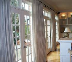 interior white traditional solid vertical folding curtain and rod