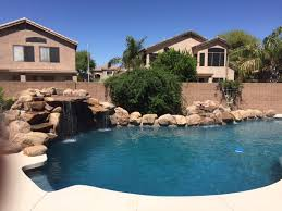 rock waterfalls for pools rock waterfall pool ideas true blue pools