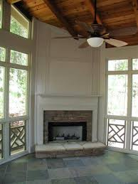 screened porch with painted corner fireplace outdoor fireplaces
