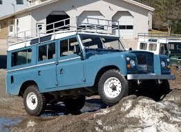 land rover series iii series truck and white wolf rim