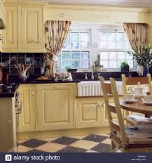 Kitchen Tiles India Patterned Curtains On Window Above Butler U0027s Sink In Cream Country