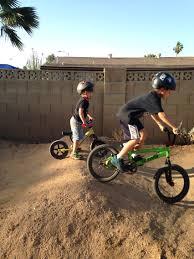jack and jonah riding in the backyard pump track bmx pump