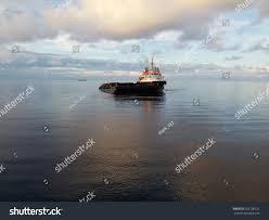 calm sea while anchor handling tug stock photo 556700221