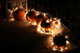 pumpkin lights outdoor fall decoration using pumpkins tulle and christmas lights