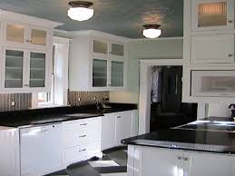 Black And White Kitchen Designs by White Kitchen Cabinets With Black Granite Countertops Contemporary