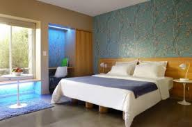 master bedroom decorating ideas in blue patterned wallpaper