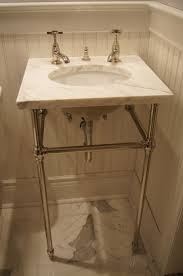 carrara marble console sink undermount sink with a marble top on console legs remodeled with