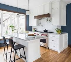 wall kitchen white cabinets a kitchen with wood flooring white cabinetry stainless