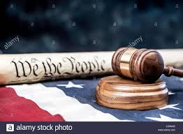 Half Of The United States The United States Constitution Rolled Up On An American Flag With