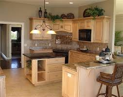 top of kitchen cabinet greenery add greenery above cabinets and some wear simple