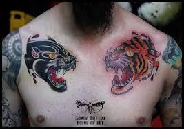 tiger and traditional panther tattoos on collarbones