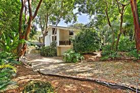 frank lloyd wright inspired home with lush landscaping frank lloyd wright inspired home in coconut grove for 2 3m curbed