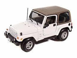 jeep cars white amazon com jeep wrangler sahara 1 18 white toys games