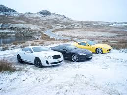 bentley snow bentley continental supersports v ferrari 599 hgte v aston martin