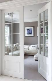 white interior glass doors make a pocket door like this and put photographs over glass panes