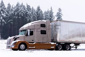 brown and light brown colors semi truck and white trailer on