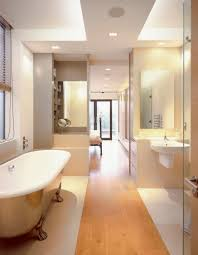 long narrow bathroom design with glass partition and laminate