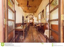 open window to cozy dining room of old style cafe in indian city