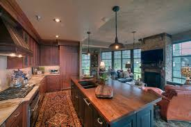black walnut wood kitchen cabinets distressed black walnut island countertop in rustic