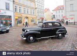 opel germany old black vintage opel car in the market place in hanseatic wismar