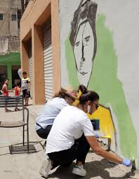 street art brings colour to rundown beirut suburb edgeprop my artists draw a mural on a wall as part of the