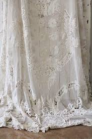 lace curtains made from joining a variety of laces trims and
