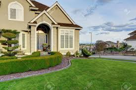 luxury house with small entrance porch walkway and curb appeal