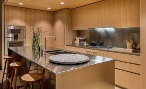 Oak Cabinets In Kitchen by Oak Cabinets And Satin Finish Stainless Steel Make Up This Modern