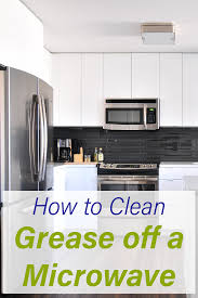 how to remove grease from the top of kitchen cabinets how to clean a microwave even those pesky grease stains