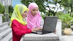two young pretty asian muslim business woman in head scarf with