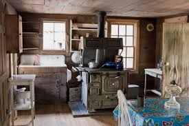 Painting Interior Log Cabin Walls by Grey Wooden Kitchen Cabinet With White Wooden Table On Laminate