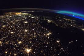 a photo from space shows belgium shining bright and social media