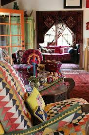bohemian house interiors with colorful seating covers and area rug