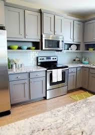 gray kitchen cabinet ideas gray cabinets herringbone tile walnut farmhouse sink