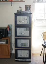 metal filing cabinet makeover filing cabinet makeover mod podge to the rescue