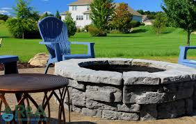 mattawan outdoor living area and landscape design with fire pit