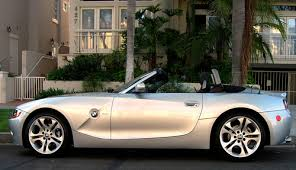 bmw z4 convertable silver bmw z4 convertible with the sun shining the side