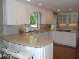white kitchen with grey subway tile backsplash tiles colored